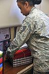 Staff Sgt. Sheminka Jordan prepares a Welcome Box 150407-F-LV269-004.jpg
