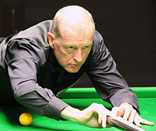 Steve Davis playing a shot with a rest