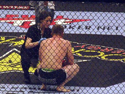 A ring-side doctor attends to a fighter following a loss. Strikeforce trainer 2010-01-07.jpg