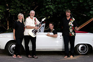 Bob Berryhill - Bob Berryhill's The Surfaris lineup: Bob Berryhill (in white), his wife Gene, and their two sons, Joel (in driver's seat) and Deven