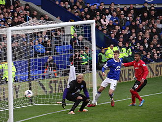 John Stones - Stones and Everton goalkeeper Tim Howard defending against Fraizer Campbell of Cardiff City in March 2014