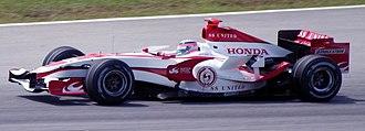 Aguri Suzuki - Takuma Sato driving for Super Aguri F1 at the 2007 Malaysian Grand Prix.