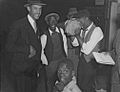 Tamoubrine Player Baby Doll celebration in New Orleans Louisiana in 1942.jpg