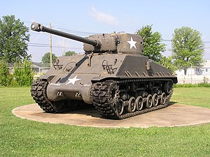 M4A1. Note the A1's round-edged, fully cast upper hull; also note the 75 mm gun used on most Shermans.