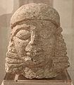 Testa maschile in pietra calcarea, 610-550 ac ca., da tumulo di molinello.JPG