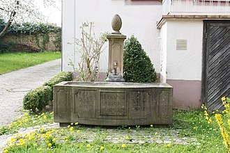 Ebringen - Tetradelphion Fountain at Ebringen's presbytery with the abbreviated names of the four exiled monks