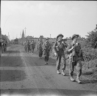 44th Infantry Brigade (United Kingdom) - Infantrymen of the 8th Battalion, Royal Scots march towards St Pierre Tarentaine, France, 3 August 1944.