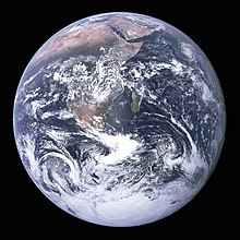 The Blue Marble photograph of Earth, taken by the Apollo 17 mission. The Arabian peninsula, Africa and Madagascar lie in the upper half of the disc, whereas Antarctica is at the bottom.