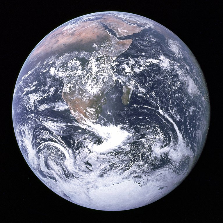The Blue Marble is a famous photograph of the Earth taken on December 7, 1972, by the crew of the Apollo 17 spacecraft en route to the Moon at a distance of about 29,000 kilometres (18,000 mi). It shows Africa, Antarctica, and the Arabian Peninsula.