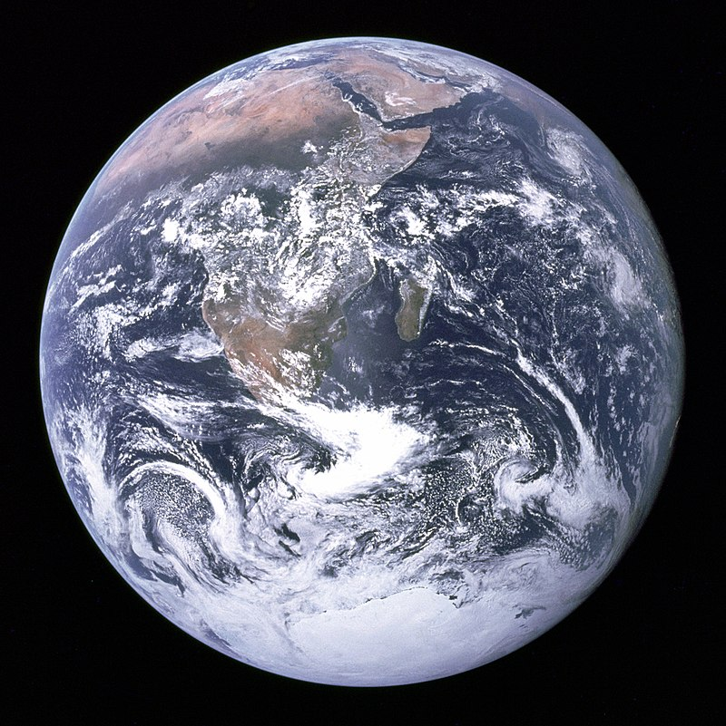 """The Blue Marble"" photograph of Earth, taken by the Apollo 17 lunar mission. The Arabian peninsula, Africa and Madagascar lie in the upper half of the disc, whereas Antarctica is at the bottom."