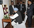 The Prime Minister, Dr. Manmohan Singh writing his message in the condolence book after paying tributes at the mortal remains of the former Prime Minister, Shri Inder Kumar Gujral, in New Delhi on December 01, 2012.jpg