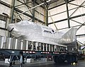 The X-38 lifting body research vehicle, seen here wrapped in a protective material, lowered onto a t DVIDS713632.jpg
