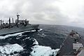 The fast combat support ship USNS Rainier (T-AOE 7), left, performs a replenishment at sea with the guided missile destroyer USS McCampbell (DDG 85) during Foal Eagle 2013 in the Yellow Sea March 20, 2013 130320-N-TG831-200.jpg