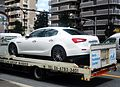 The rearview of Maserati Ghibli III on the delivery vehicle of Hakko Car Group.JPG