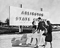 Three students walking in front of Arlington State College sign (10008778).jpg