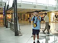 Tourist in shopping area of Hong Kong International Airport.jpg