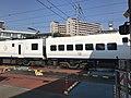 Train of Kagoshima Main Line passing Sangyo University Crossing.jpg