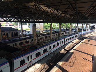 Kuala Lumpur railway station - KTM Komuter Class 92 and Class 83 trains waiting at the newer wing of Kuala Lumpur station, built during the 1986 refurbishment.