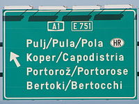 Trilingual traffic sign on A1 near Koper.jpg
