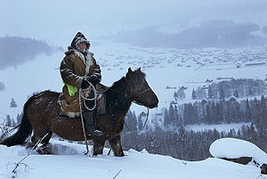 Tuvans - Tuvan on a horse.