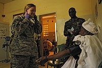 U.S. Air Force Captain Sara Burton, left, a nurse with the Vermont Air National Guard, and Gambian National Army 2nd Lt. Abdoulie Faal, a nurse, prepare to check a patient's blood pressure during Western 120610-Z-KE462-143.jpg