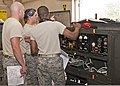 U.S. Air Force Senior Airmen Alfred Fyvie, Joshua Ruberg and Mister Braxton, all with the 361st Training Squadron, check the wiring diagram panel to troubleshoot an electrical problem June 8, 2011, at Sheppard 110608-F-NS900-030.jpg