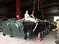U.S. Army 1st Lt. Laura Condyles sitting on top of a training BMP Tank.jpg