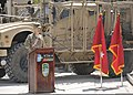 U.S. Army Lt. Gen. Kenneth E. Tovo, the commander of NATO Training Mission-Afghanistan (NTM-A) and Combined Security Transition Command-Afghanistan (CSTC-A), speaks during a change of command ceremony at Camp 130402-N-HU588-033.jpg