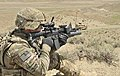 U.S. Army Sgt. Joshua Clark with the 591st Engineer Company looks down the sights of his M203 grenade launcher as he provides security for U.S. Air Force bomb technicians outside an Afghan Border Police 130401-A-MX357-061.jpg