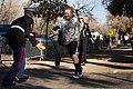 U.S. Marine Corps Staff Sgt. Thomas Matlock, a recruiter in Phoenix, Ariz., hands off a football to a boy before the Fiesta Bowl Parade in Phoenix, Ariz., Dec. 31, 2011 111231-M-BZ983-750.jpg