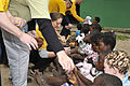 U.S. Navy Lt. Christie Kehoe, center, and other Sailors hand out stuffed animals donated by Loving Hugs to children at the Integracao Infantil Cristo Vida school in Nacala, Mozambique, June 20, 2012 120620-N-UG232-244.jpg