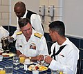 U.S. Navy Vice Chief of Naval Operations Adm. Mark E. Ferguson, second from right, speaks to Seaman Recruit Luis Maldonado during a breakfast at Recruit Training Command at Naval Station Great Lakes, Ill., Sept 120921-N-IK959-002.jpg