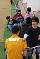 U.S. Sailors assigned to Naval Mobile Construction Battalion 1 and Commander, Fleet Activities Okinawa participate in an English through play community relations event at the Busy Bee International School 140307-N-EP471-249.jpg
