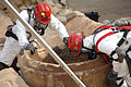 U.S. military service members, dressed in protective gear, inspect a concrete hole during a joint training exercise conducted by the U.S. Air Force and the U.S. Army involving biological and chemical warfare 080626-A-BB257-073.jpg