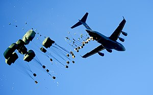 437th Airlift Wing - C-17 of the 437th AW airdrops pallets of water and food to Mirebalais, Haiti, 21 Jan 2010