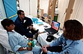US Navy 030324-N-6077T-005 Lt. j.g. Ramzy Azar and Military Sealift Command hospital Corpsman 2nd Class Bobbi Bowman enjoy a movie with an Iraqi civilian being treated aboard the Military Sealift Command hospital ship USNS Comf.jpg