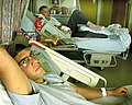 US Navy 030403-N-2338M-001 U.S. Marine Corporals and best friends Samuel Velazquez and Nicholas Elliot recover with hospital care after being wounded in combat.jpg