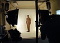 "US Navy 031016-N-5134H-002 Lt. Cmdr. Warren Clark assigned to the ""Totems"" of Patrol Squadron Sixty Nine (VP-69), gets his picture taken for his service record by Photographer's Mate 2nd Class Michael Winter.jpg"
