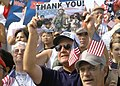 US Navy 031025-N-4388F-019 Supporters of America's fight against terrorism show their patriotic colors and gratitude during the Defenders of Freedom parade held in the City of Oceanside, Calif.jpg