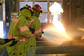 US Navy 040114-N-1194D-003 Sailors assigned to the amphibious dock landing ship USS Fort McHenry (LSD 43) handle a fully charged fire hose on a class alpha fire during firefighting training at the Yokosuka Afloat Training Group.jpg