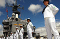 US Navy 040628-N-6932B-191 Sailors assigned to the amphibious assault ship USS Tarawa (LHA 1) man the rails as the ship approaches Naval Station Pearl Harbor, Hawaii.jpg