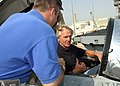 US Navy 041011-N-4565G-005 Commanding Officer, Strike Fighter Squadron Eight Three, Cmdr. Reggie Carpenter, left, gives professional golfer Greg Norman a tour of the cockpit of an F-A-18C Hornet.jpg