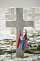 US Navy 041216-N-3236B-019 A lone decorated headstone stands beside 5,076 other headstones containing the remains of American World War II military veterans at the American Military Cemetery in Luxembourg.jpg