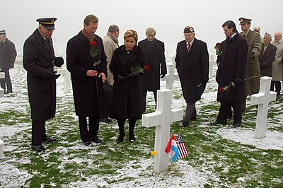 US Navy 041216-N-3236B-020 The Grand Duke Henri and The Grand Duchess Maria Teresa laid flowers at a tomb of a fallen World War II U.S. Solider at the American Military Cemetery in Luxembourg.jpg