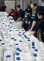 US Navy 050104-N-4166B-184 Sailors aboard USS Abraham Lincoln (CVN 72) preposition jugs of purified water made for those in need of humanitarian assistance in Aceh, Sumatra, Indonesia.jpg