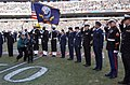 US Navy 050123-N-4729H-062 Marines, Sailors and Airmen assigned to Philadelphia, Pa., area bases, salute during the National Anthem prior to the start of the National Football League National Football Conference championship ga.jpg