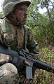 US Navy 050627-N-9866B-043 U.S. Marine Corps Cpl. Jason Dobos waits on the side of the road for his simulated enemy.jpg