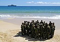 US Navy 050629-N-1397H-079 U.S. Marines assigned to the 3rd Amphibious Assault Battalion based out of Camp Pendleton, Calif., gather around for a brief before launching Amphibious Assault Vehicles (AAVs) from the beach.jpg