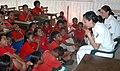 US Navy 050826-N-8146B-005 Operations Specialist Seaman Kenia E. Aguilar-Ulloa and Damage Controlman Fireman Griselda B. Bonilla talk to Marshallese first-grade students during a community outreach project in Majuro, Marshall I.jpg