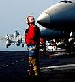 US Navy 051209-N-9362D-005 An Aviation Ordnanceman observes as an F-14D Tomcat launches off the flight deck.jpg
